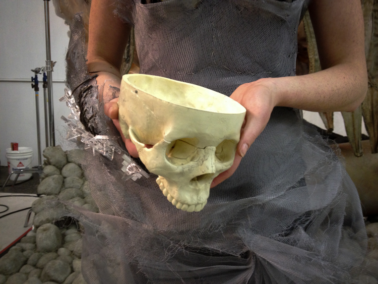 A replica human skull was used for the scene.